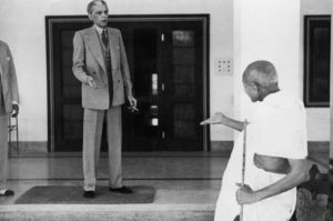 Mohandas Karamchand Gandhi (1869 - 1948) leaves the home of Muhammad Ali Jinnah (1876 - 1948, left), founder of the Muslim League, en route to the Viceroy's Lodge in Delhi, 24th November 1939. (Photo by Kulwant Roy/Topical Press Agency/Hulton Archive/Getty Images)